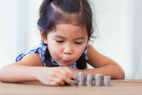 little girl and coins